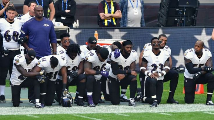 players taking a knee
